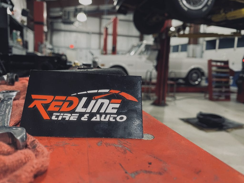 redline tire and auto sign
